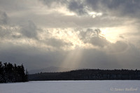 Sun breaking through clouds, Barnum Pond